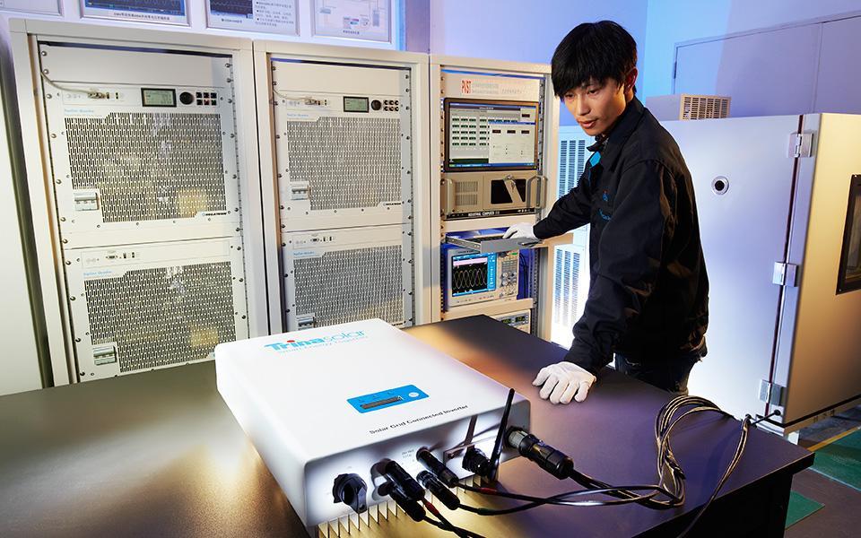 Technician operating Trina Solar technical equipment