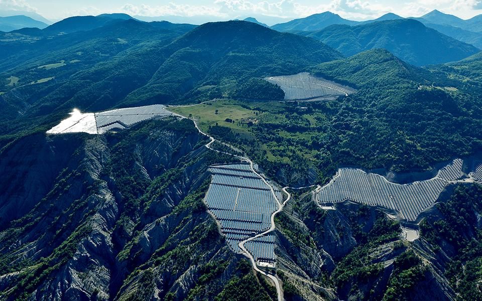 Aerial view of large-scale utility solar installation in mountains